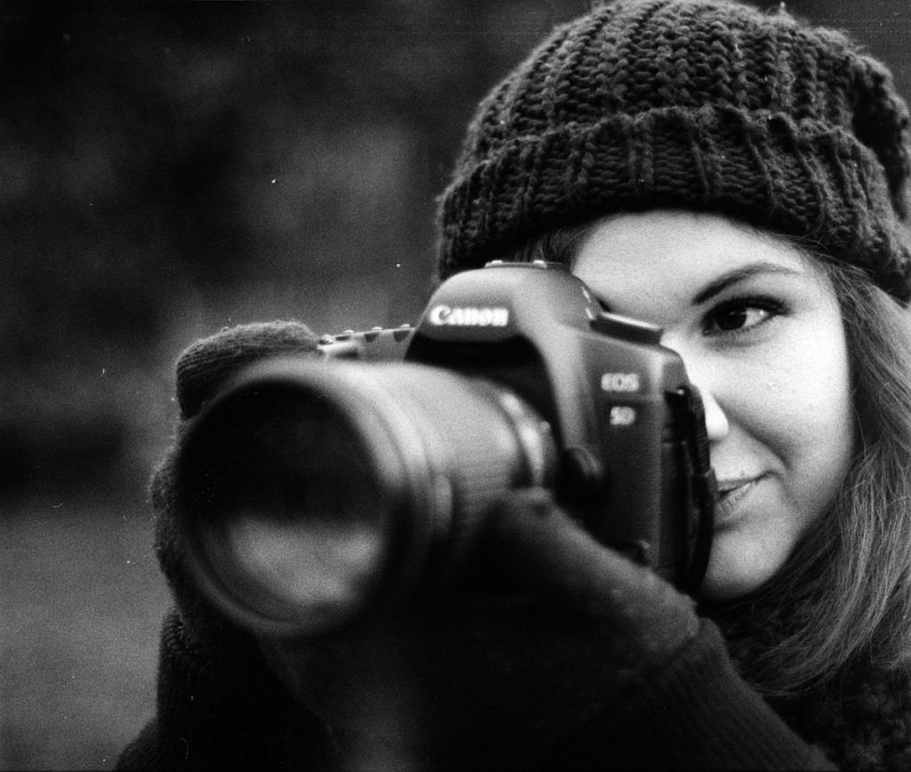 woman using camera - private investigator